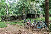 Bicycles Near A Temple Ruin At Angkor Wat, Cambodia