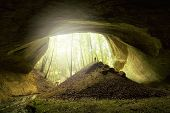 Cave entrance with beautiful light and man