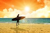 stock photo of board-walk  - Illustration of a surfer walking at the beach during sunset - JPG