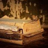 foto of annal  - Old books of the Old binder are stacked on a wooden surface - JPG