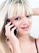 Portrait Of Attractive Teen Girl Smiling While Phoning