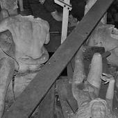 Broken Statues Among Debris