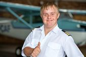 Young Pilot With Down Syndrome Showing Thumbs Up.