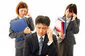 Stressed businessman and businesswomen