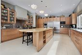 Kitchen in luxury home with wood island