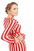 Portrait of a charming woman in extravagant striped dress. Isolated over white.