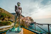 Ancient Sculpture And View Of Manarola