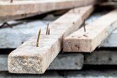 pic of split rail fence  - a sharp rusty nail stick on wood - JPG