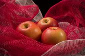 Red Apples On A Red Background
