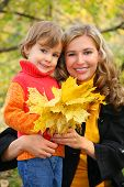 stock photo of mater  - smiling mother with daughter in autumn park - JPG