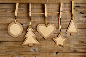 Old Paper Christmas Decorations On Wooden Background