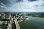SINGAPORE - SEPTEMBER 16: An aerial view of Singapore river and coast line, buildings and highways o