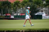 KUALA LUMPUR - OCTOBER 12: Michele Wie of USA reacts after putt on the 2nd hole green of the KLGCC course on Day 3 of the Sime Darby LPGA on October 12, 2013 in Kuala Lumpur, Malaysia.