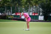 KUALA LUMPUR - OCTOBER 12:Brittany Lang of USA putts on the 2nd hole green of the KLGCC course on Day 3 of the Sime Darby LPGA on October 12, 2013 in Kuala Lumpur, Malaysia.