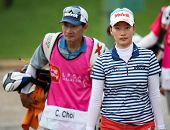 KUALA LUMPUR - OCTOBER 12: Chella Choi of South Korea walks to the 2nd hole green of the KLGCC course on Day 3 of play at the Sime Darby LPGA on October 12, 2013 in Kuala Lumpur, Malaysia.