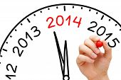 stock photo of chronometer  - Hand drawing New year 2014 concept with marker on transparent wipe board - JPG