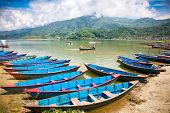 POKHARA,NEPAL-MAY 25: Floating is a major tourist attraction on Fewa (Phewa) lake in Pokhara, Nepal