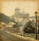 Retro image of Karlstejn Castle in the Czech Republic. added  paper texture.