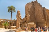 LUXOR, EGYPT - APR 10: Unidentified tourists at Statue of Ramesses II in Karnak temple of Luxor on 1