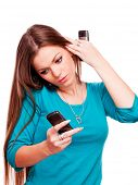 Beautiful young brunette talking on the mobile phone and holding mobile phone in each hand - isolate
