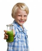 pic of smoothies  - A happy smiling boy holding out a bottle of green smoothie or juice. Focus on smoothie. Isolated on white.