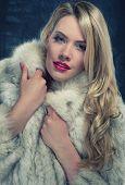 Pretty blonde woman in a warm winter coat