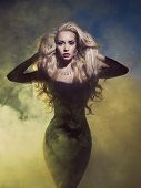 stock photo of diva  - Fashion art photo diva coming out of the smoke - JPG
