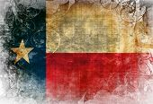 image of texans  - Texan flag waving in the wind with some spots and stains - JPG