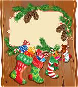 X-mas And New Year Card With Family Christmas Stockings On Wood Background. Frame With Empty Space F
