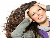 image of hair blowing  - Beauty Woman with Long Curly Hair - JPG