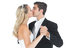 picture of waltzing  - Young married couple dancing viennese waltz kissing each other on white background - JPG