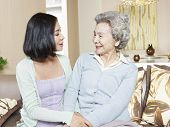 stock photo of mother law  - senior asian mother chatting with adult daughter at home - JPG