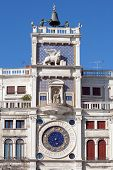 The 15th Century Clock Tower in San Marco's square, Venice, Italy. The two huge bronze figures on to