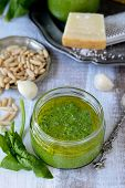 image of pine nut  - Spinach pesto in a glass jar - JPG