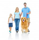 Happy Family Walking  with Dog