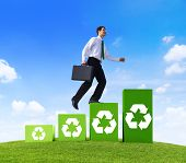 Environmentalist Businessman Running Up Recycling Steps