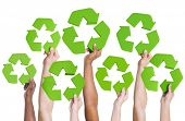 Diversity of Hands Holding Green Recycling Symbol