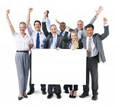 Multi-ethnic Group of Business People Celebrating with Banner