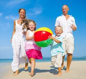 Family Playing with Beach Ball on Beach