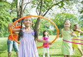 Children Playing with Hula Hoops in Park