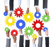 Teamwork: Business Hands Holding Gears