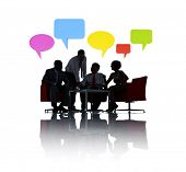 Silhouette of Business Meeting with Speech Bubbles