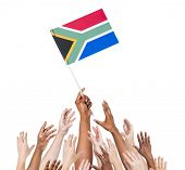 Diverse and Multiethnic Hands Holding The Flag of South Africa