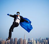 Superhero Businessman Flying Over New York City