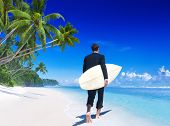 Businessman With Surfboard On Tropical Beach