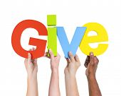 stock photo of alphabet  - Diverse Hands Holding The Word Give - JPG