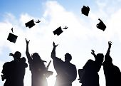 stock photo of degree  - Group Of Diverse International Students Celebrating Graduation - JPG