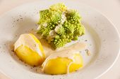 picture of romanesco  - One serving Romanesco with boiled potatoes and cheese sauce on a large white plate - JPG