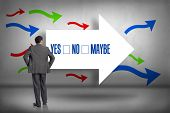 The word yes no maybe and businessman with hands on hips against arrows pointing