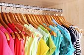 foto of wardrobe  - Colorful clothes hanging in wardrobe - JPG